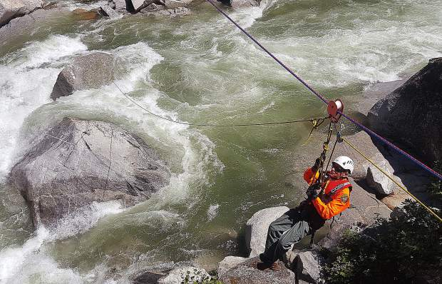 Nevada County Sheriff's Search and Rescue volunteer Gary Smith takes his first practice run at a roped river rescue Thursday, with the help of Nevada County Consolidated firefighters.