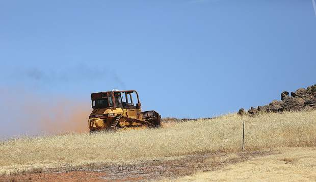 Cal Fire dozer 2346 reinforces a fire break line around the 81-acre grass fire which burned near Smartsville and Browns Valley Monday afternoon.