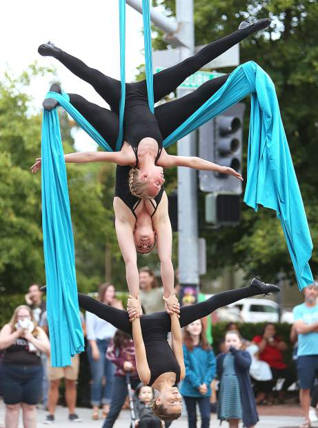 Air Aligned aerialists Liliana Fouyer (from top) Cassandra Merrick, and Zoey Stueck perform in front of the crowds of the Thursday Night Market.