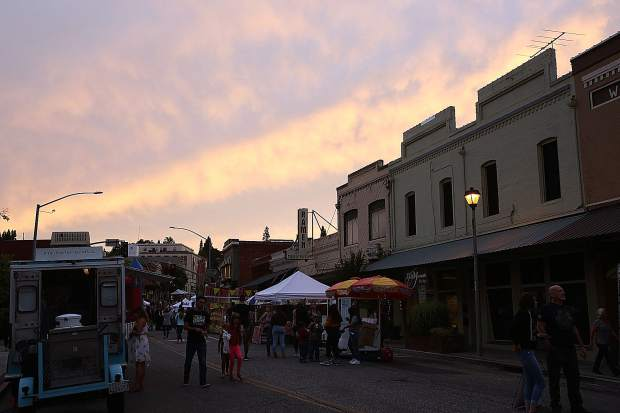 The evening ends with a vibrant sunset over downtown Grass Valley during the inaugural Thursday Night Market of the summer season.