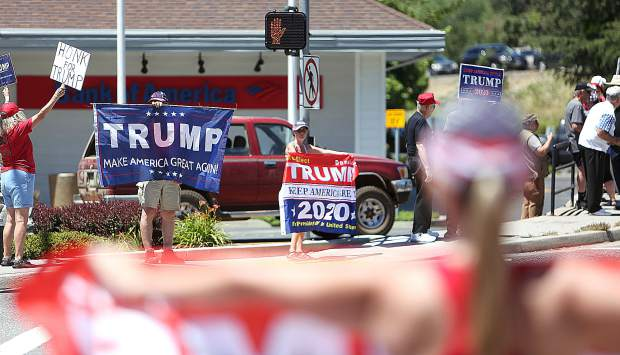 Trump supporters garner honks and cheers from passersby Tuesday at the Brunswick and Sutton Way intersection. About 40 showed up to support President Trump's re-election efforts which he officially kicked off.