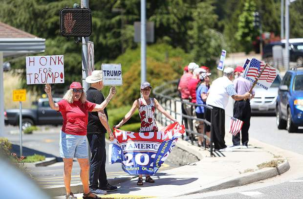 About 40 President Trump supporters took to the intersection of Brunswick and Sutton Way Tuesday afternoon to show support for his re-election campaign, which Trump launched today. The rally members held signs and cheered when people honked their horns in support.