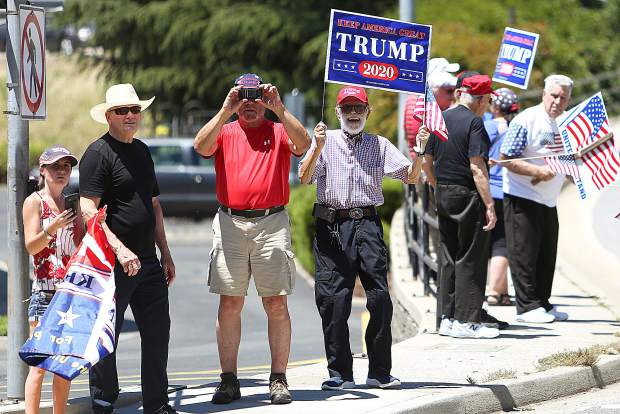 President Trump supporters stand at the Brunswick and Sutton Way intersection where they received honks of support from passersby as well as some gestures of disapproval.