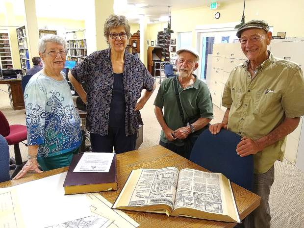 Pat Chesnut (from left), Shirley DicKard, Hank Meals, and Darshan Zenith stand behind the last known complete collection of The Western Slopes Connection, a now defunct newspaper that published Nevada County counterculture news from the mid to late 70s.