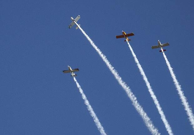 Pilots perform a missing man formation for a local pilot that died this year. The planes performed at the Grass Valley Airshow.