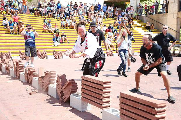 Local martial artist Kirby DeLaunay smashes brick breaking record