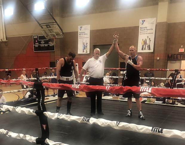 Local boxer Brian Scott, right, won the men's 35-45, heavyweight (201-plus pounds) division at the Las Vegas Masters Invitational Tournament on Sunday. Scott won the title bout by TKO.