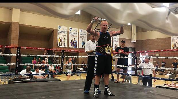 Local boxer Brian Scott won the men's 35-45, heavyweight (201-plus pounds) division at the Las Vegas Masters Invitational Tournament on Sunday. Scott won the title bout by TKO.