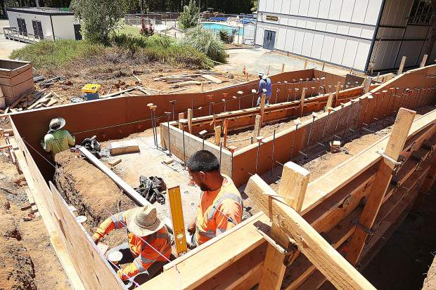 Construction workers are busy forming concrete molds for new handicap accessible ramps at Nevada Union High School.