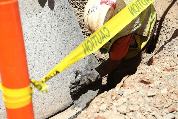 A Hansen Brothers construction worker shores up a storm drain with some concrete Tuesday morning on the Nevada Union High School campus.