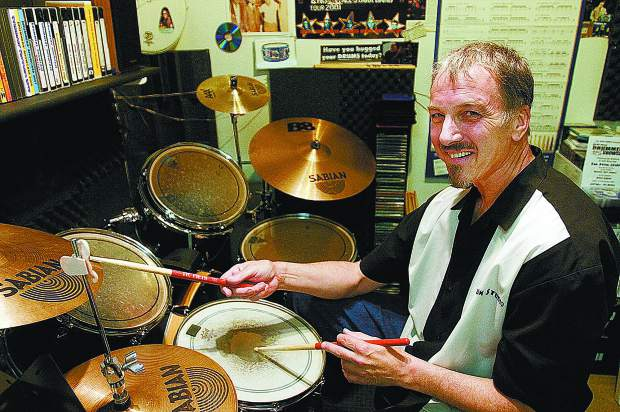 John Basa plays the drums in  The Drum Studio in this 2011 archive photo.