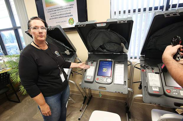 Clerk-Recorder assistant Ali O'Brien indicates where the paper receipt system keeps a hard copy of a voters actions when using an electronic voting booth at the Nevada County Elections Office at the Rood Government Center. The Gold Miners Inn in downtown Grass Valley will also have a vote center established.