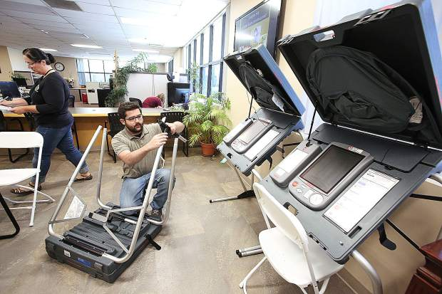 Nevada County Clerk-Recorder assistant Kristian Hamilton works on setting up voting booths at the Rood Government Center in advance of the Assembly District 1 election being held for the seat vacated by Brian Dahle when he won the Senate District 1 seat.