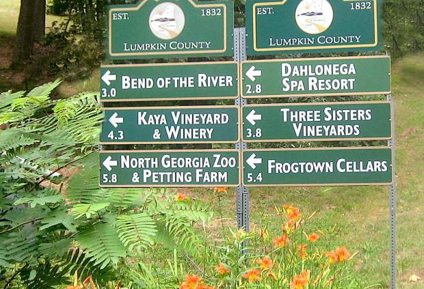 Directional winery sign in Dahlonega, Georgia, points the way to wineries in the area.