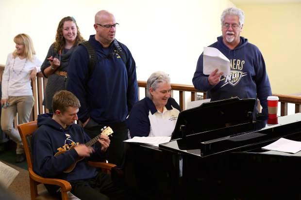 Nevada Union basketball team and faculty sings Christmas carols at Eskaton Village in Grass Valley in 2015. Jeff Dellis is stepping away from his positions as a teacher and athletic director at Nevada Union. Dellis has been a teacher at NU since 1996 and athletic director since 2014.