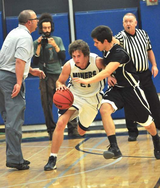 Jeff Dellis, left, is seen here coaching during the 2012 Nevada Union Invitational Tournament, is stepping away from his positions as a teacher and athletic director at Nevada Union. Dellis has been a teacher at NU since 1996 and athletic director since 2014.