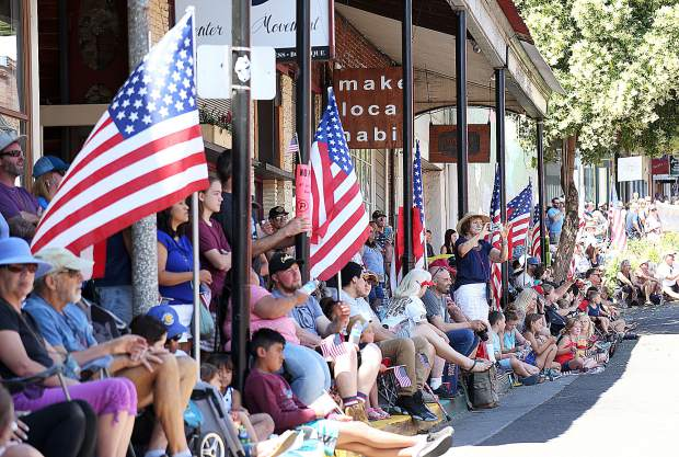 Folks line Main Street in downtown Grass Valley during Thursday's Nevada County Fourth of July Parade. The parade alternates between Nevada City and Grass Valley each year and next year will take place in Nevada City.