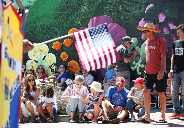 The youth of NEO, New Events and Opportunities make their way along Mill Street during the Fourth of July parade in downtown Grass Valley.