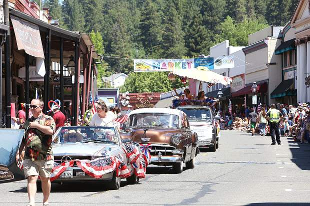 Classic car selections including vehicles that took part in the Great Race roll down Mill Street in downtown Grass Valley during Thursdays Fourth of July parade.