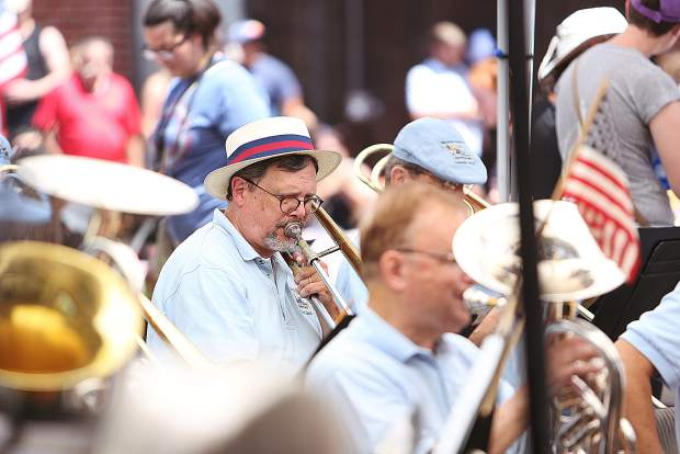 Members of the Nevada County Concert band members dress the part as they take up the role as the official music ensemble of the downtown Grass Valley Fourth of July Parade from the Wells Fargo Bank parking lot.