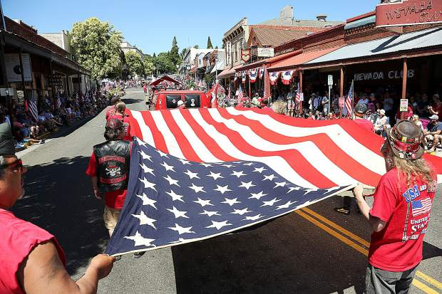 Members of the local chapter of the E. Clampus Vitus walk along the parade route during Thursday's Fourth of July parade through the streets of downtown Grass Valley. Next year the parade will take place in downtown Nevada City.