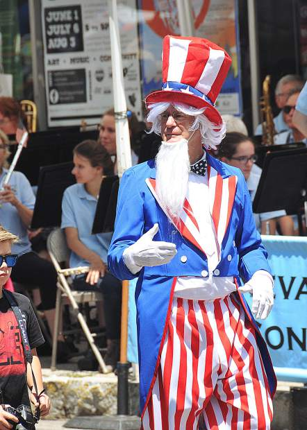 Uncle Sam walks down Broad Street promoting the Famous Marching Presidents during the 2018 Independence Day Parade.