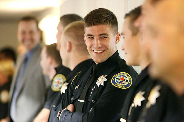 Grass Valley Police Department new hire Jonathan Brown smiles prior to Tuesday evening's Grass Valley City Council meeting where Brown and six other new hires were recognized.
