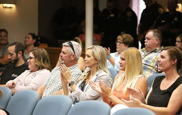 Members of the audience applaud the seven new Grass Valley police hires after their introduction during Tuesday's Grass Valley City Council meeting.