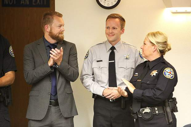 information and technology analyst Brad Kalstein, left, and community service officer Bryce Corkins, center, were applauded by council members, community members, and fellow officers in attendance at Tuesday's Grass Valley City Council meeting.