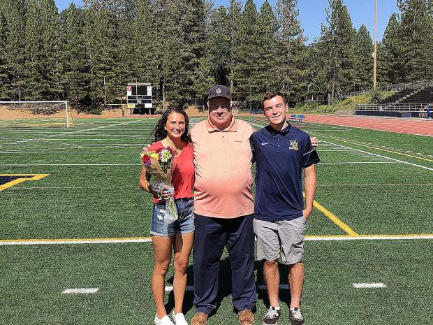 Bill Gardner, middle, presented Dylan McGilvary, right, and Vanessa Enriquez, left, with scholarships Wednesday at Hooper Stadium. McGilvary was awarded the Justin Gardner Student Athlete Leadership Scholarship. Enriquez was awarded the Justin Gardner Humanities Scholarship.