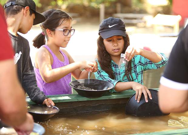 Arely Zaragoza and Mia Garcia were more interested in collecting agates and quartz crystals during their gold panning demonstration.