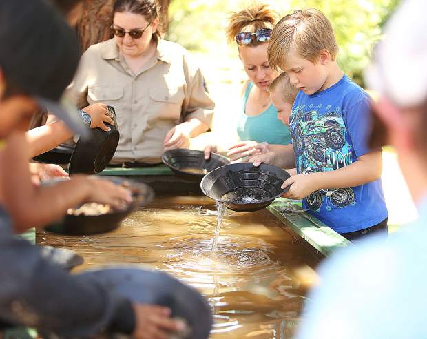 Bodhi Figueroa tests his gold panning technique Saturday alongside his family at the South Yuba River State Park, Bridgeport.