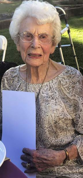 Birthday girl Elma Eden Baker turned 100 years old July 1, and celebrated with friends and family the weekend before. Here she's holding one of her special gifts: a poem written by Molly Fisk (Nevada County Poet Laureate 2017-2019) commissioned by Elma's grandson, Richard Baker.