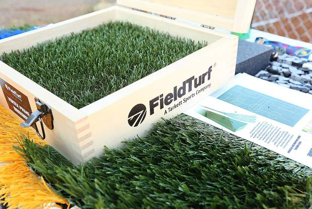 Samples of synthetic FieldTurf were on hand to show community members what the finished product will be made out of during Thursday evening's Lyman Gilmore Field Turf ground breaking ceremony.