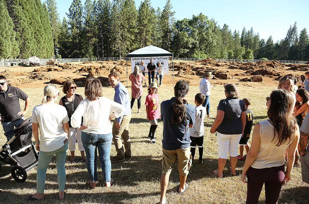 Community members gather on the fields of the Lyman Gilmore Middle School for a ground breaking ceremony for the school's new synthetic turf field Thursday afternoon.