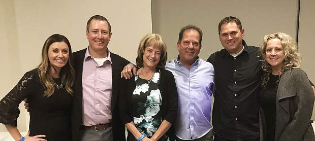 From left, the three owners of DC Solar Electric, Chasin Scott, Len Stevens and Derek Stevens, pose with their wives, Valerie, Nancy and Regan.