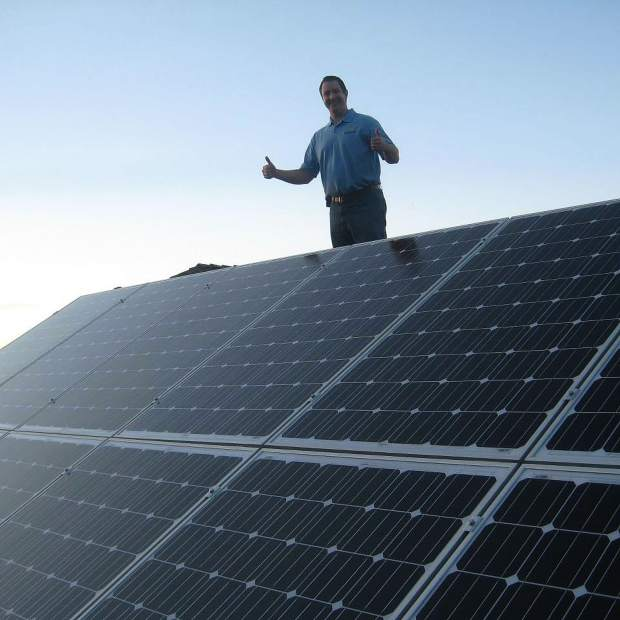 Chasin Scott, co-owner of DC Solar Electric, gives his final approval on a recent solar panel installation.