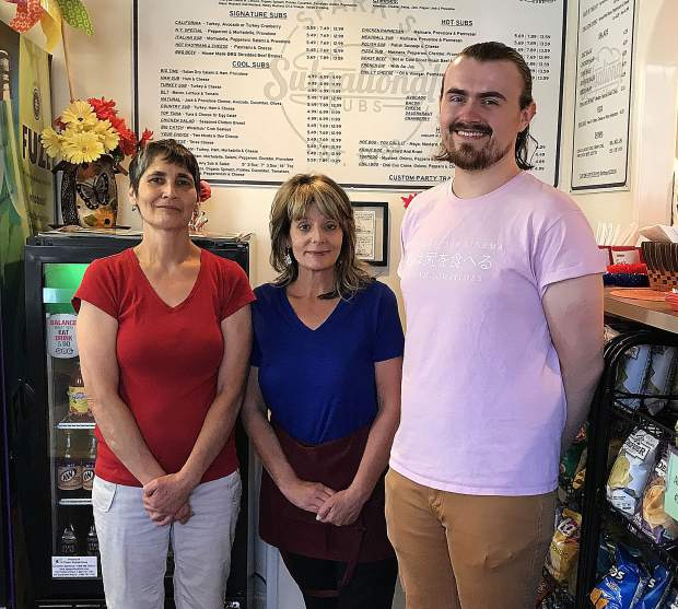 Spark's Subsational Subs owners Terri Alvarado, left and Dennae Cromer, middle, pose with manager Justus Talley.