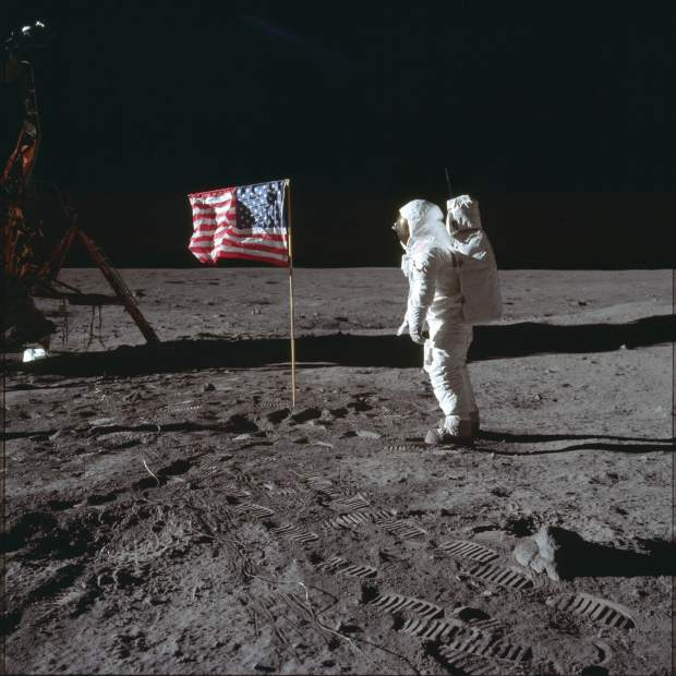 ADVANCE FOR USE SATURDAY, JULY 13, 2019 AND THEREAFTER-In this July 20, 1969 photo made available by NASA, astronaut Buzz Aldrin Jr. poses for a photograph beside the U.S. flag on the moon during the Apollo 11 mission. Aldrin and fellow astronaut Neil Armstrong were the first men to walk on the lunar surface with temperatures ranging from 243 degrees above to 279 degrees below zero. Astronaut Michael Collins flew the command module in orbit. (Neil Armstrong/NASA via AP)