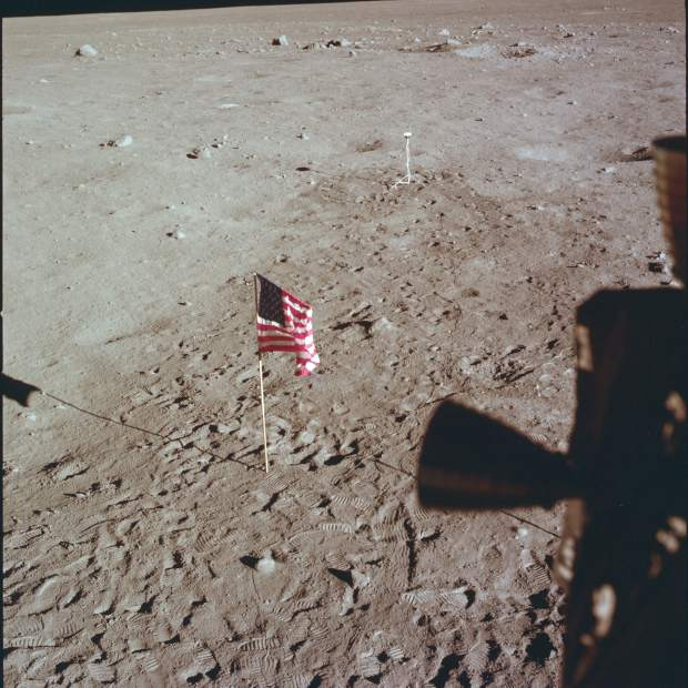 ADVANCE FOR USE SATURDAY, JULY 13, 2019 AND THEREAFTER- This July 21, 1969 photo made available by NASA shows Tranquility Base and the U.S. flag from a window on the Lunar Module as Neil Armstrong and Buzz Aldrin prepare for liftoff from the surface of the moon. (NASA via AP)