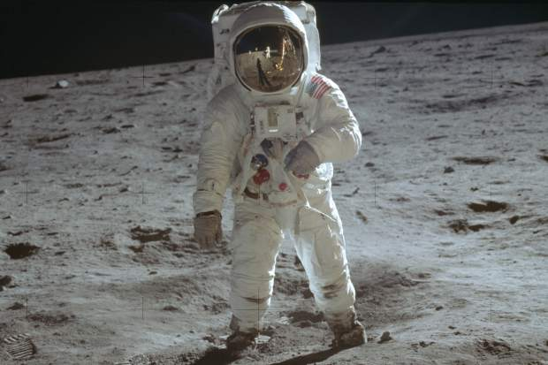 ADVANCE FOR USE SATURDAY, JULY 13, 2019 AND THEREAFTER-In this July 20, 1969 photo made available by NASA, astronaut Buzz Aldrin, lunar module pilot, walks on the surface of the moon during the Apollo 11 extravehicular activity. (Neil Armstrong/NASA via AP)
