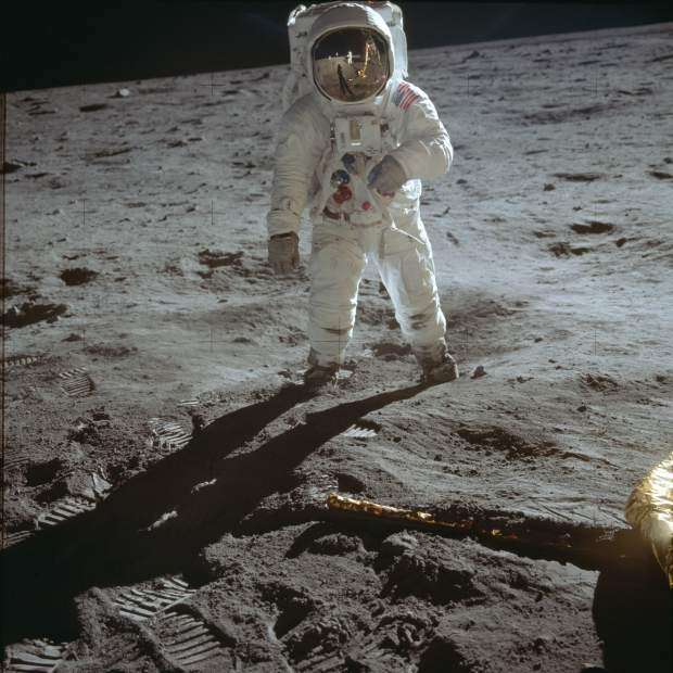 ADVANCE FOR USE SATURDAY, JULY 13, 2019 AND THEREAFTER-In this July 20, 1969 photo made available by NASA, astronaut Buzz Aldrin, lunar module pilot, walks on the surface of the moon near the leg of the Lunar Module