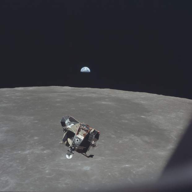 ADVANCE FOR USE SATURDAY, JULY 13, 2019 AND THEREAFTER-In this July 21, 1969 photo made available by NASA, the Apollo 11 Lunar Module ascent stage, carrying astronauts Neil Armstrong and Buzz Aldrin, approaches the Command and Service Modules for docking in lunar orbit. Astronaut Michael Collins remained with the CSM in lunar orbit while the other two crewmen explored the moon's surface. In the background the Earth rises above the lunar horizon. (Michael Collins/NASA via AP)