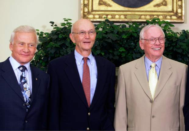 ADVANCE FOR USE SATURDAY, JULY 13, 2019 AND THEREAFTER-In this July 20, 2009 file photo, Apollo 11 astronauts, from left, Buzz Aldrin, Michael Collins and Neil Armstrong stand in the Oval Office at the White House in Washington, on the 40th anniversary of the mission's moon landing. (AP Photo/Alex Brandon)