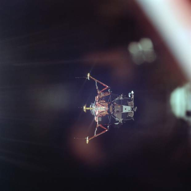ADVANCE FOR USE SATURDAY, JULY 13, 2019 AND THEREAFTER-In this July 20, 1969 photo made available by NASA, the Apollo 11 Lunar Module undocks from the Command Module on its way to the surface of the moon. (Michael Collins/NASA via AP)