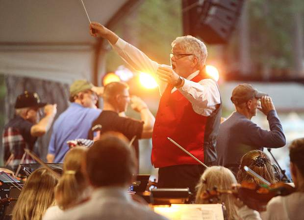 Music in the Mountains artistic director Pete Nowlen conducts the orchestra during Wednesday evening's Patriotic Pops concert at the Nevada County Fairgrounds.