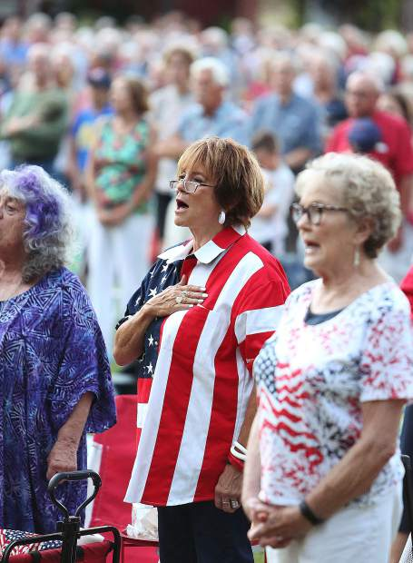 Grass Valley's Caryl Barnes sings the Star Spangled Banner along with the Music in the Mountains performance during a crowd participation portion of the evening Wednesday night at the Nevada County Fairgrounds.