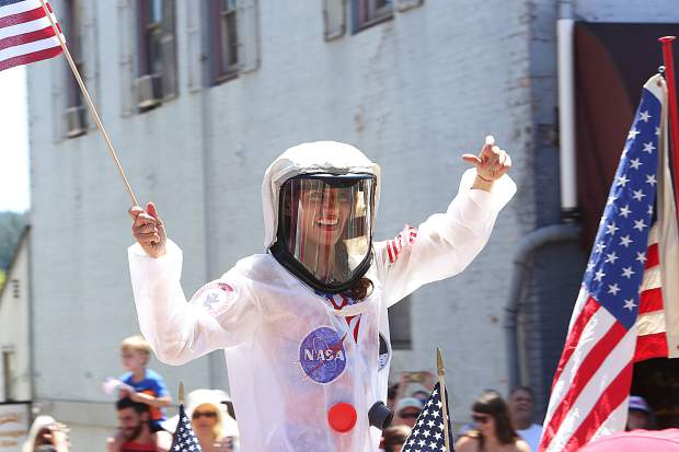 An astronaut dances on a float honoring the 50th anniversary or the Apollo 11 moon landing.