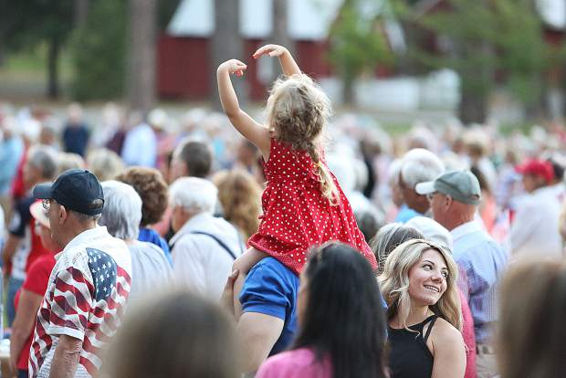 A youngster dances to the music during Wednesday evening's Music in the Mountains Patriotic Pops Concert at the Nevada County Fairgrounds.