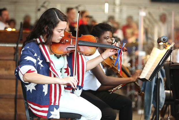 Music in the Mountains SummerFest violinist Claire Tatman warms up along with her fellow performers during the Patriotic Pops - Happy Birthday USA! Concert held July 4 at the Nevada County Fairgrounds in this archive photo.